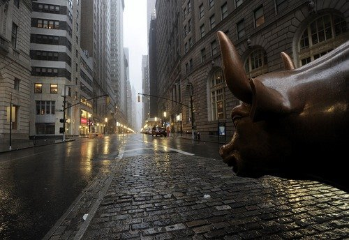 The Wall Street bronze Bull looks out to
