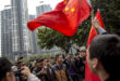 Jonah M. Kessel for the New York Times Free speech advocates and communist party supporters clash in front of the Nanfang Media Group compound, Tuesday.