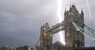 """© London News Pictures. London, UK. A stunning and once in a lifetime image of a lightening bolt striking over Tower Bridge in London, taken by amateur photographer Daoud Fakhri during a storm on January 25, 2014 . Mr Fakhri, who just happened to be testing out a new lens for his camera by taking pictures of Tower Bridge, when the lightening struck creating this amazing image. The shot was unplanned and """"pure luck"""", as he described it. . Photo credit: Daoud Fakhri/LNP"""