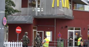 GERMANY OUT In this grab taken from video, police officers stand outside a McDonald's restaurant, near the mall, in Munich, Germany, Friday,  July 22, 2016. A manhunt was underway Friday for a shooter or shooters who opened fire at a shopping mall in Munich, killing and wounding several people, a Munich police spokeswoman said. The city transit system shut down and police asked people to avoid public places. (NONSTOP NEWS via AP)