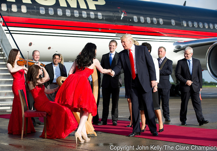 Donald Trump is greeted with music as he and his family disembark from his private plane after arriving in Shannon early this morning before heading to view his latest purchase Trump International Golf Links And Hotel Ireland. Photograph by John Kelly.