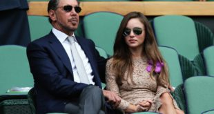 LONDON, ENGLAND - JULY 06:  Larry Ellison and Nikita Kahn sit in the Royal Box on Centre Court before the Gentlemen's Singles Final match between Roger Federer of Switzerland and Novak Djokovic of Serbia on day thirteen of the Wimbledon Lawn Tennis Championships at the All England Lawn Tennis and Croquet Club on July 6, 2014 in London, England.  (Photo by Matthew Stockman/Getty Images)