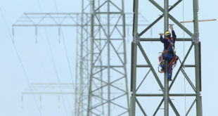 BUETZOW, GERMANY - AUGUST 08:  A worker descends from a newly-constructed transmission tower before hanging overhead power lines on August 8, 2012 near Buetzow, Germany. The German government is shuttering the country's nuclear power plants and is seeking to replace production capacity with power from renewable energy sources, especially wind turbines and solar parks, though the plan requires biilions of Euros in investments to expand the country's electricity transmission grid.  (Photo by Sean Gallup/Getty Images)