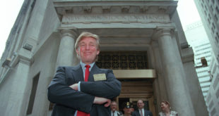 Developer Donald Trump poses for photos outside the New York Stock Exchange after the listing of his stock on Wed., June 7, 1995 in New York.  He took his flagship Trump Plaza Casino public, offering 10 million shares of common stock at an estimated price of $14 per share.  (AP Photo/Kathy Willens)