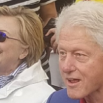 Hillary Emerges From Crypt, Dons Anti-Seizure Glasses For Cloudy Memorial Day Parade