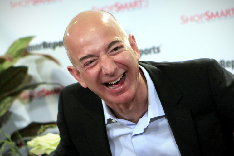 Amazon.com President, CEO and Chairman Bezos  laughs as he answers a question at the Consumer Reports headquarters in Yonkers