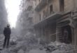 A man stands in the debris of a building Friday after an airstrike allegedly carried out by the Russian miliary in a part of Aleppo controlled by the Syrian opposition.