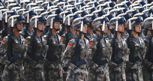 Chinese soldiers take part in a parade commemorating the 70th anniversary of Japan's surrender during World War II in front of Tiananmen Gate in Beijing, Thursday, Sept. 3, 2015. The spectacle involved more than 12,000 troops, 500 pieces of military hardware and 200 aircraft of various types, representing what military officials say is the Chinese military's most cutting-edge technology. (AP Photo/Ng Han Guan)